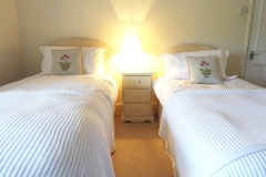 The Coach House bedroom 3 twin beds